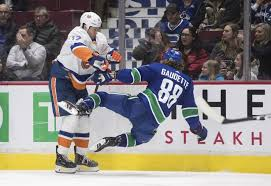 Miller scores only goal in shootout, Canucks top Islanders