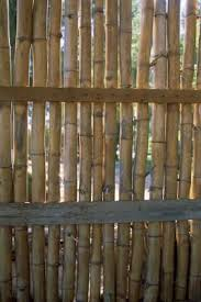 How To Install A Stand Alone Reed Fence Homesteady Bamboo Fence Backyard Fences Natural Fence