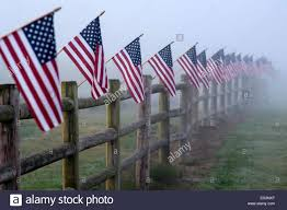 Farmland With The American Flag Attached To Fence With Early Morning Stock Photo Alamy