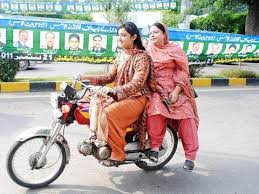 Image result for woman riding motor bike in pakistan