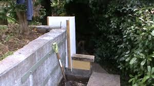 repairing old concrete garden retaining