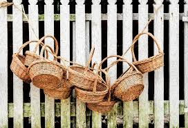Baskets Hanging On Picket Fence Photograph By Gary Slawsky
