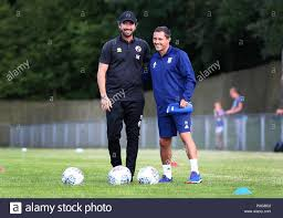 Crawley Town's head coach Harry Kewell talks with Ipswich Manager ...