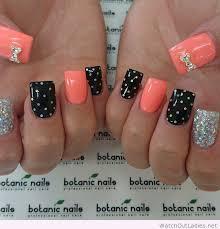 botanic nails orange black and silver