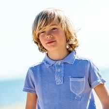 cute boy wearing blue polo shirt