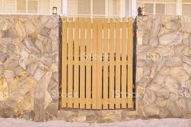 Wooden Fence Door And Pole Lamp With Rock Slice Wall Decoration Stock Photo Download Image Now Istock