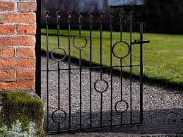 wooden gates vs metal which one is