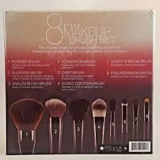 makeup brush with pink storage case