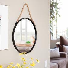round black wall mirror with hanging