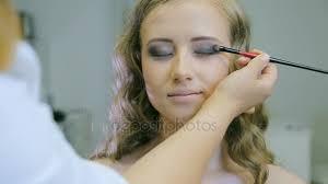 professional makeup artist applying