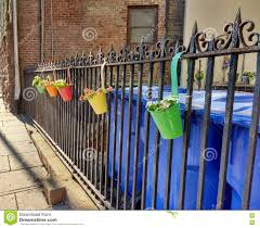 Colorful Flower Pots Hanging On A Fence Stock Image Image Of Gardening Fences 74199673