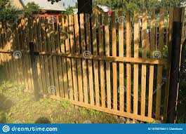 Rustic New Wooden Fence With Black Metal Posts And Gates Garden And Vegetable Garden Fence On A Sunny Summer Day Stock Photo Image Of Dark Building 157837564