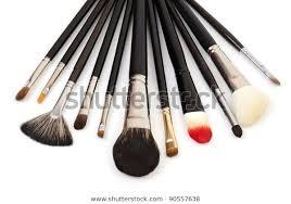 makeup brushes on white stock photo