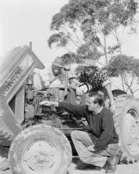 BBM Youth Support - Our training farm in 1964: Manager Ray de Faux  instructing Bill Evans, 16, from Berkshire (left), Ivan Hamilton, 18, from  Northern Ireland, in tractor engine maintenance. A lot