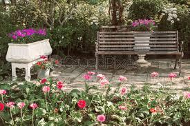 bench seat chair in garden park stock