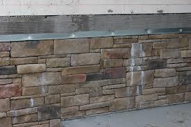 cleaning manufactured stone masonry