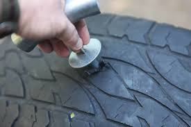 how to use a tyre puncture repair kit