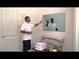 tv behind a mirror you