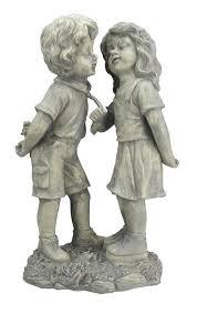 boy and girl first kiss garden statue