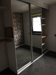 2 mirror sliding wardrobe doors plus