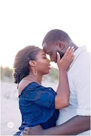 Intimate shot of NFL player engagement photos on the beach with ...