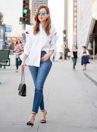 Sydne Style shows how to do the half tuck with a white button down ...