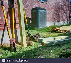 Building New Fence Backyard With Modern Air Conditioner Shovels And Lumber For New Privacy Fence Stock Photo Alamy