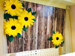 Giant Crepe Paper Sunflowers Cardboard Picket Fence Made A Perfect Backdrop For The Spring Themed Baby Sh Paper Sunflowers Sunflower Party Baby Shower Flowers