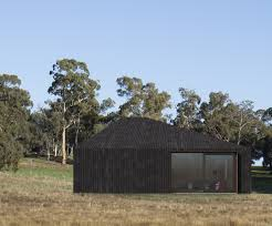 adam kane architects designs asymmetrical timber cabin in rural ...