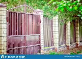 Modern Metal Gates And A Fence With Brick Columns Stock Photo Image Of Carcass Architecture 144212708