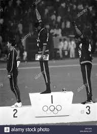 Tommie Smith and John Carlos making a Black Power salute during ...