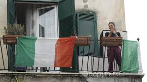 Italians sing from balconies amid ...