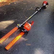 Redmax Trimmer With Echo Hedge Trimmer Attachment And An Echo Hedge Trimmer Love The Reach Outdoor Power Equipment Hedge Trimmer Attachments Hedge Trimmers