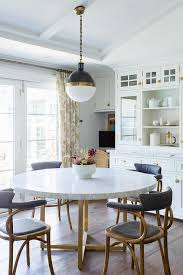 marble dining table with vintage chairs