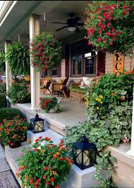 Pin by adela carr on gardens and patios | Small flower gardens, Front porch  decorating, Front porch design
