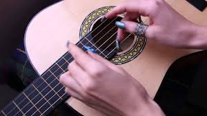 how to play guitar with long nails