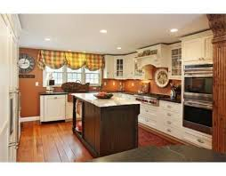 kitchen with ivory cream cabinets and