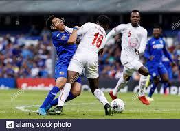 Cruz Azul's Alex Castro (L) in action against the Portmore United ...