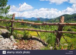 Rustic Native Style Wooden Fence Overlooking Beautiful Green Valley In Sagada Philippines Stock Photo Alamy