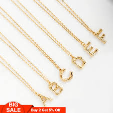 tiny gold letter necklace big bamboo