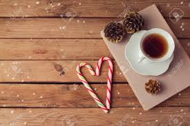 Christmas Holiday Tea Cup On Old Books With Candy On Wooden Table.. Stock  Photo, Picture And Royalty Free Image. Image 40986602.