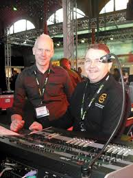 Slideshow (5 s) | Alistair Smyth and Aaron Cripps of A.C. Entertainment  Technologies on the Ard Soilse stand. A Jands Vista I3 is in picture.