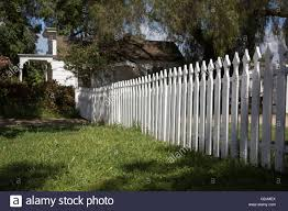 White Farm House With Picket Fence And Garden Stock Photo Alamy