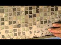 remove dried grout or mortar from tile