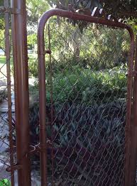 I Just Spray Painted My Chain Link Fence And Gate Looks So Much Better Any Spray Paint Meant For Me Painted Chain Link Fence Fence Design Chain Link Fence