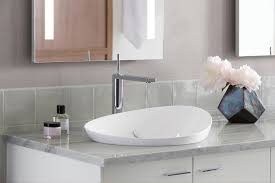 a minimalist bathroom sink by kohler