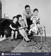 Tottenham Hotspur player Bobby Smith with wife and children at home Stock  Photo - Alamy