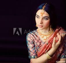sweet real indian in sari smiling