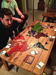 risk game board carved into a coffee table