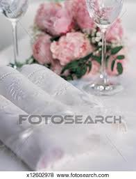 wine glasses and a bouquet of flowers
